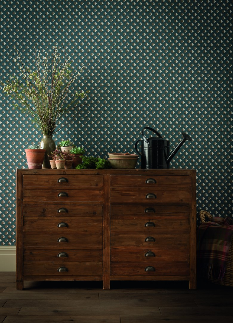 Function and style in a rural home chest and wallpaper