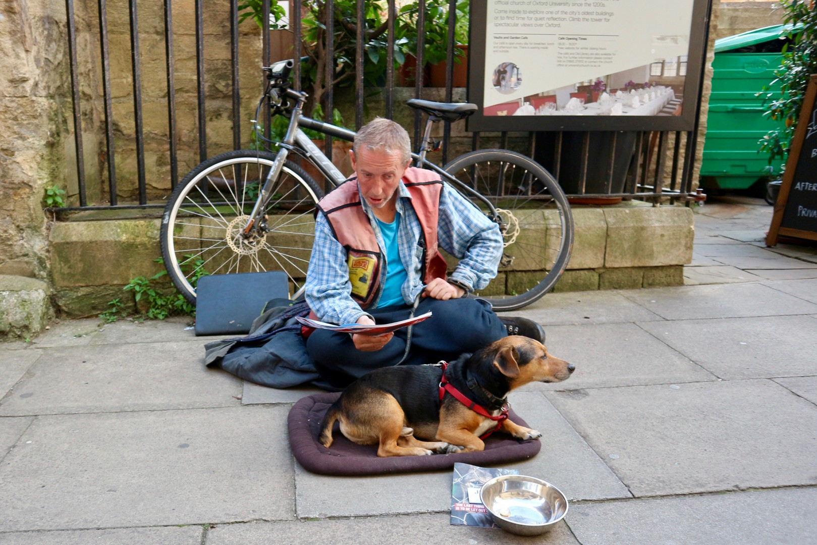 Oxford England 25 August 2017 A homeless sitting at street with his dog
