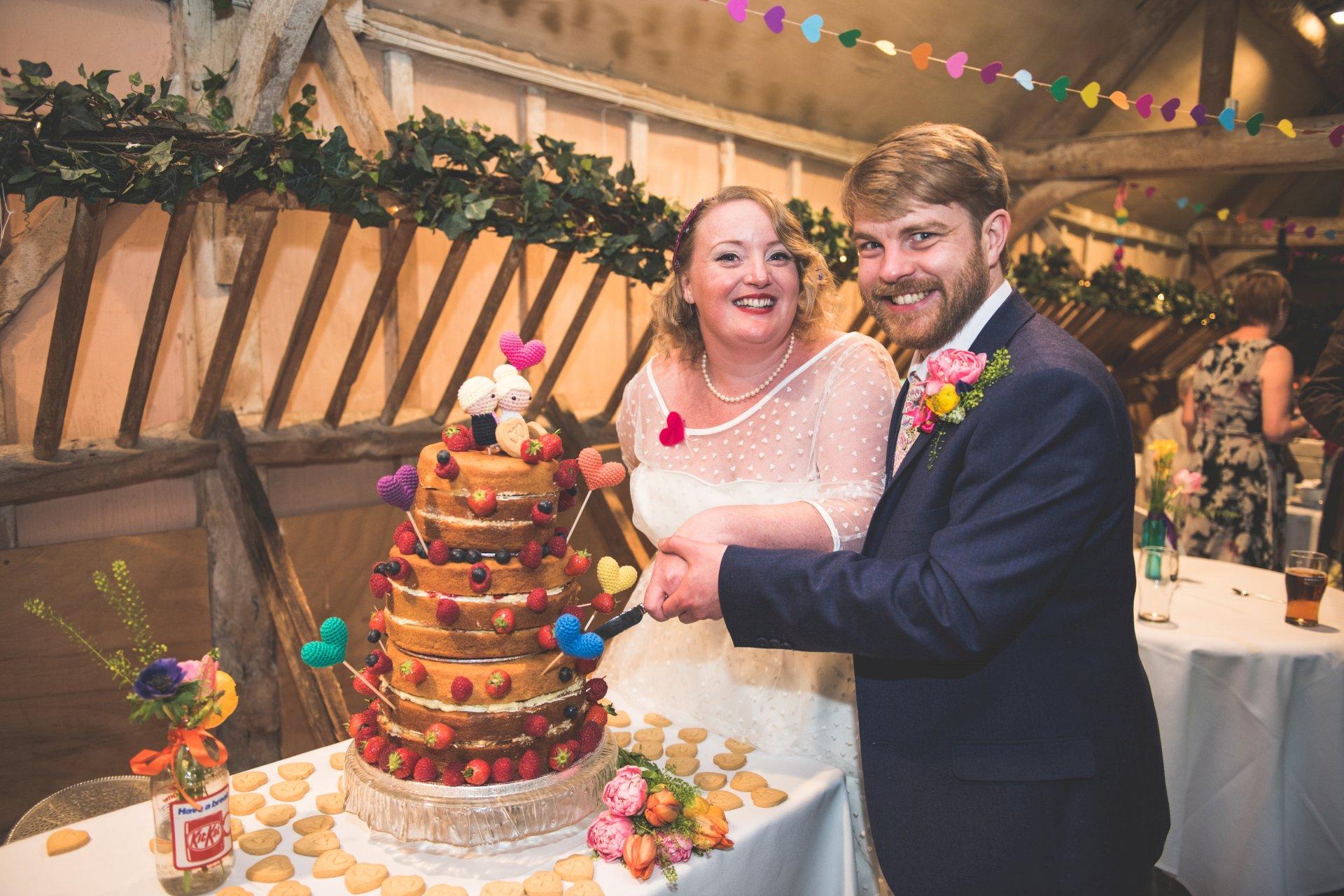 Real Wedding Chris Rachel cutting the cake