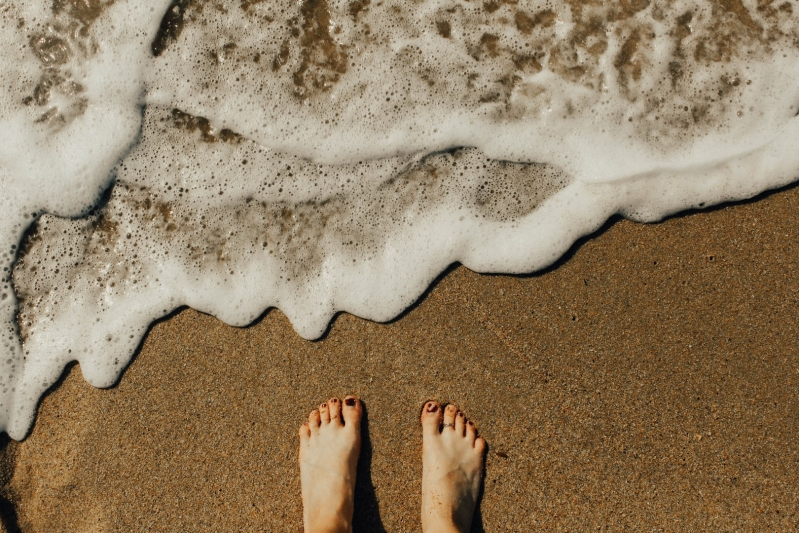 Escape The Comfort Zone Woman Feet in Sand by the Sea