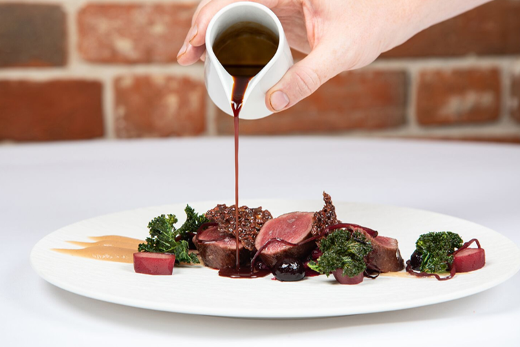 LOrtolan Review Meat Dish with Gravy Pouring