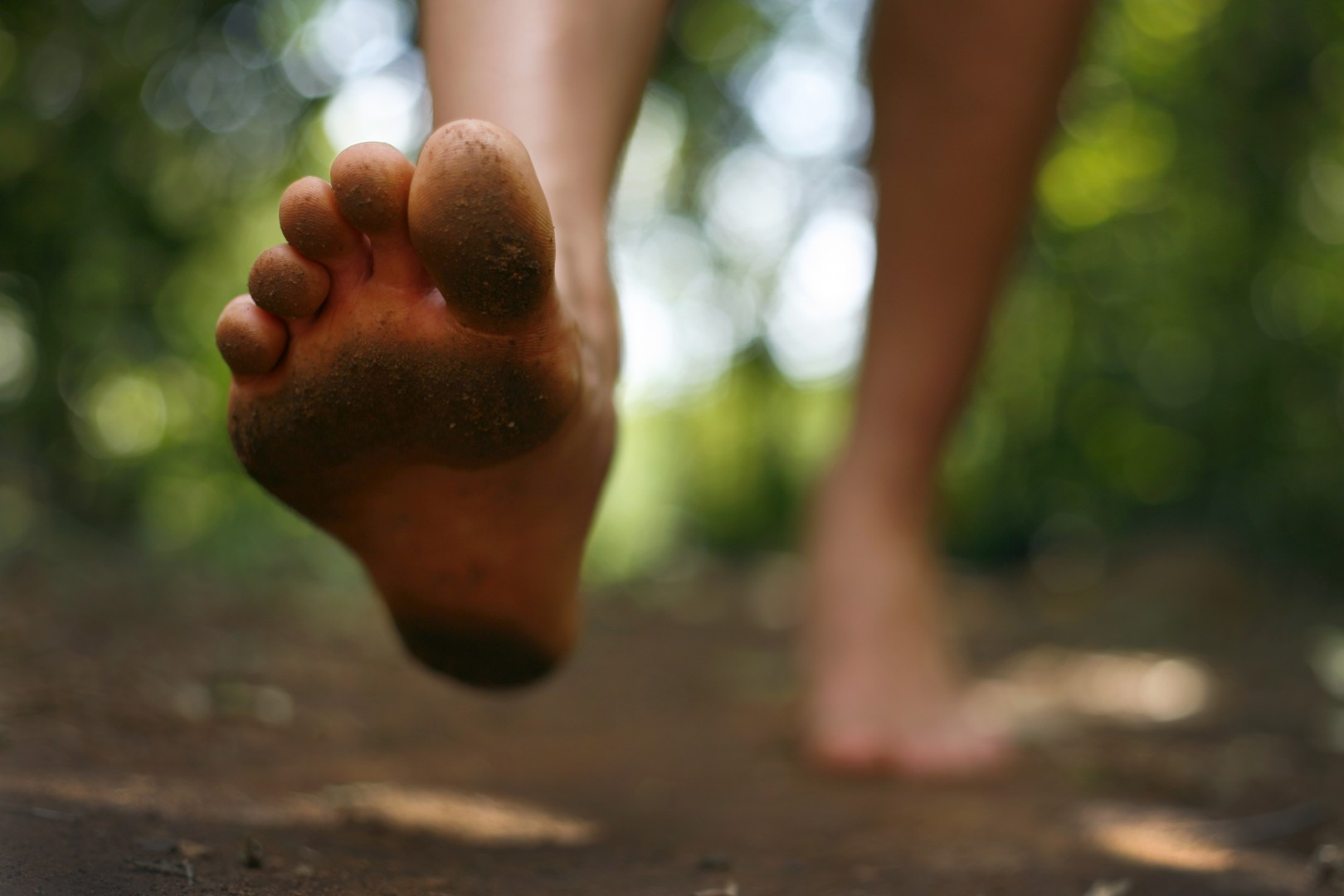 Page Turner June Crossing Bare Foot Young Man in Forest Trail
