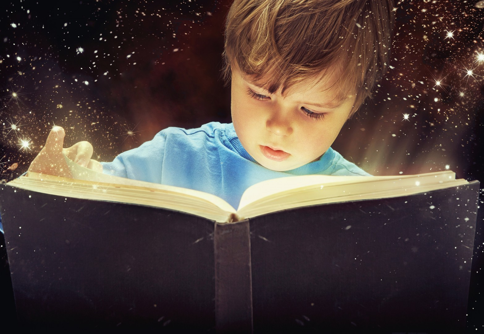 Sharing the Love of Reading Boy with Magic Book
