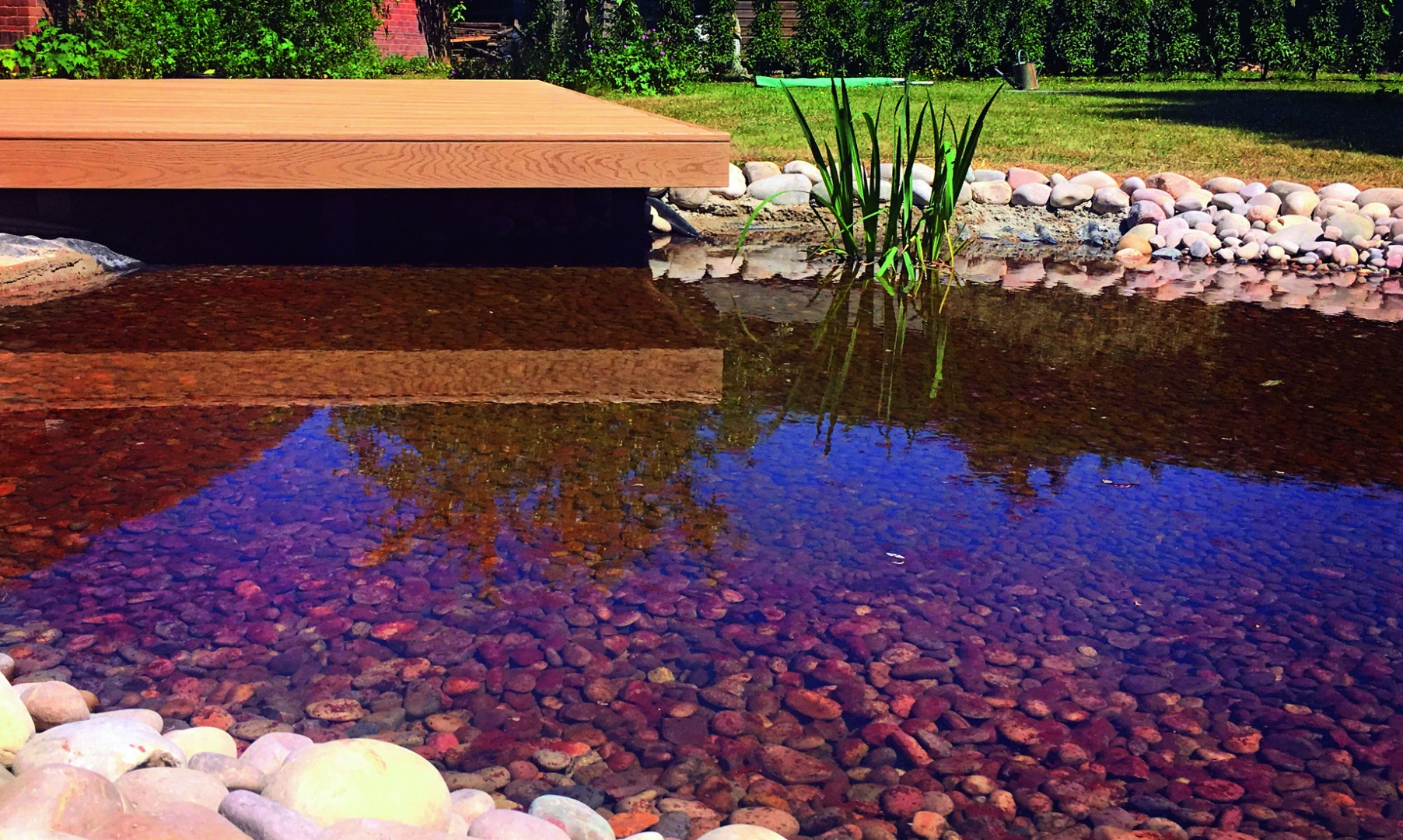 Landscaping a Natural Spa Pond with Oversail Deck