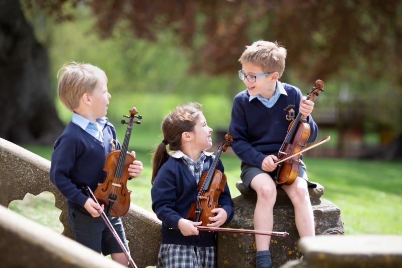 Beachborough pupils playing the violin