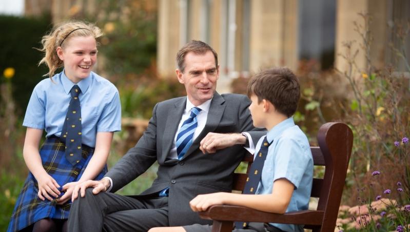 Beachborough headmaster with students