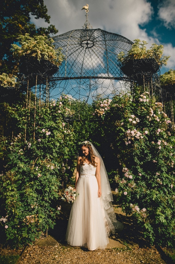 The Dairy at Waddesdon Manor Wedding Bride in front of Pergola