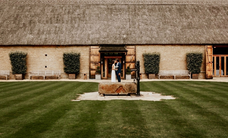 Tythe Barn Wedding Couple Outdoor ceremony